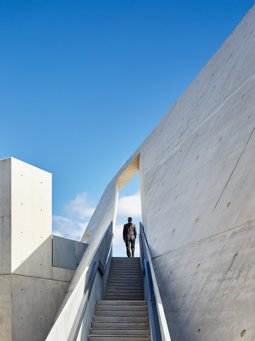 Son of Holocaust Survivor  walks through the Arch at the National Holocaust Monument
