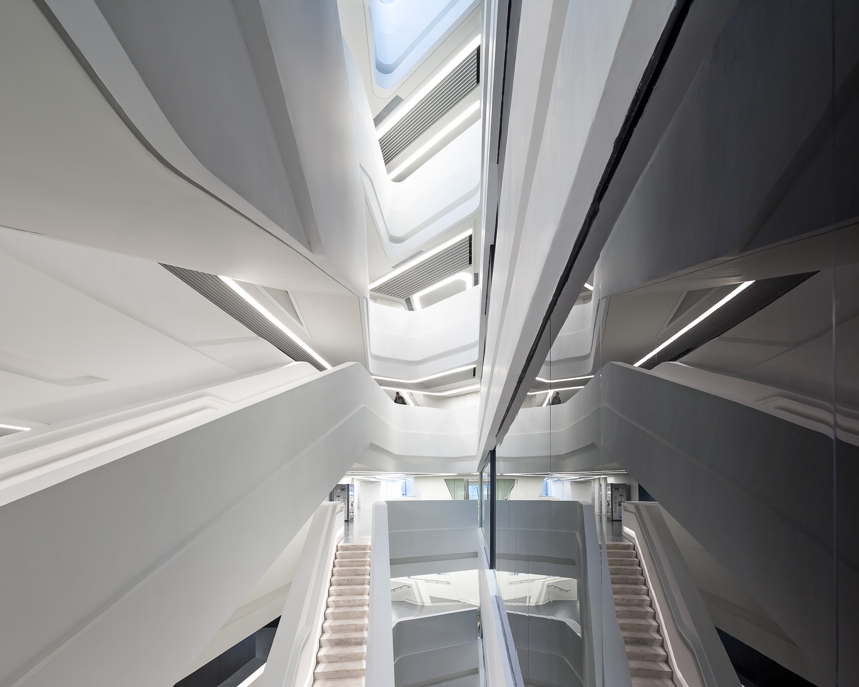 Symmetrical Atrium reflection at the innovation_tower_by_zaha_hadid_architects-56.jpg